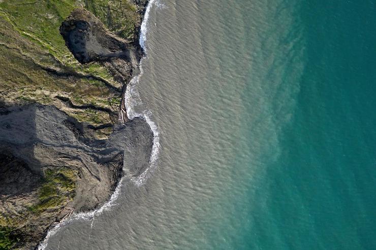 foto permafrost che si scioglie erosione artico